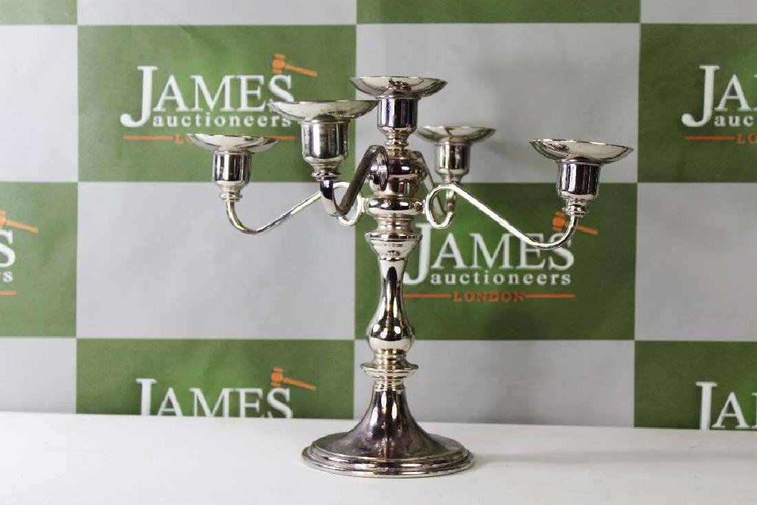 A Four Branch Silver Plated Candelabra, 23cm High