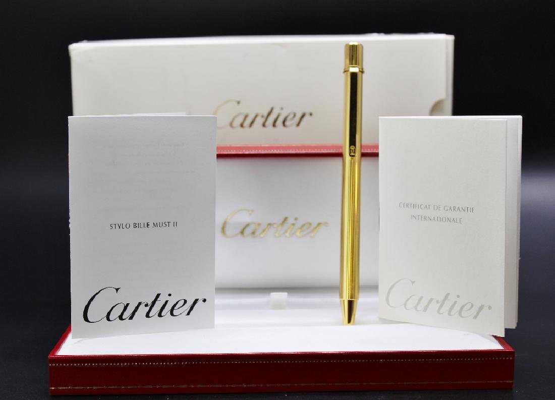 A Cartier pen & case, manual etc