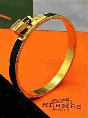 Hermes Gold Kelly Cadena Lock & Black Leather Bangle