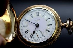 A gent`s gold filled full hunter pocket watch by Elgin.