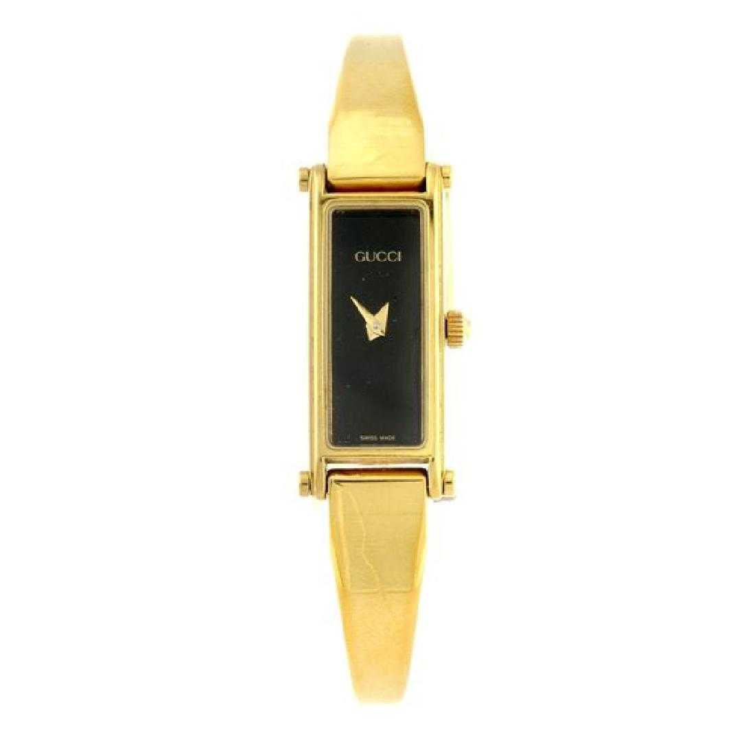 6e9e726e0c1 A Lady`s Gucci 1500l gold plated watch