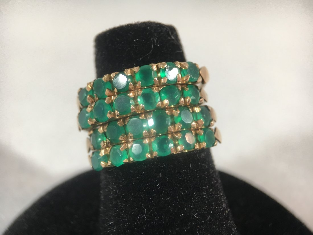 Modern 4 Band Emerald Studded Ring set in 14k gold