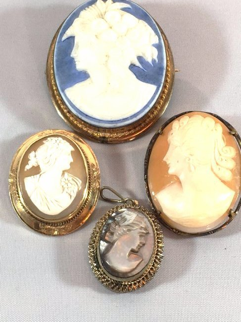 Lovely lot of 4 Cameo Brooches set in Sterling and Gold
