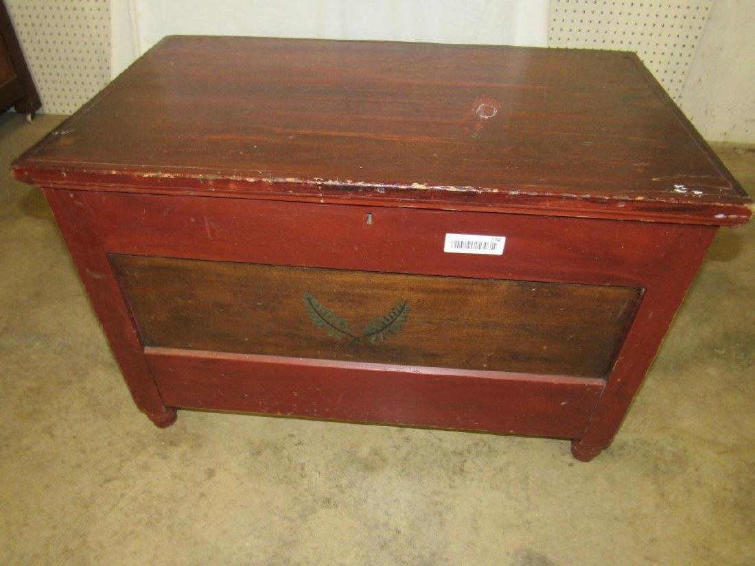 Early painted blanket chest with carved till
