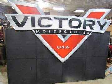Huge Victory Motorcycle dealership showroom sign