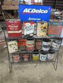 AC Delco battery display shelf and 15 various oil cans
