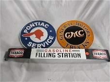 New Pontiac and GMC metal signs and Texaco metal door