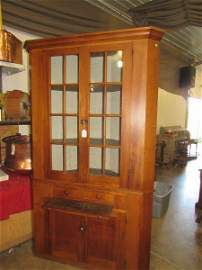 Excellent 16 pane two-piece corner cupboard