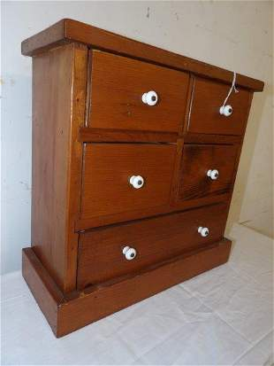Five drawer apothecary cabinet with porcelain pulls