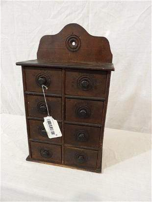 Eight drawer hanging spice cabinet