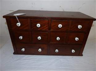 10 drawer apothecary cabinet with porcelain pulls