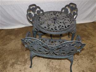 Fancy ornate child's cast metal table and chair set