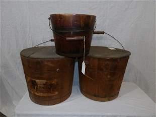 Three primitive wooden buckets