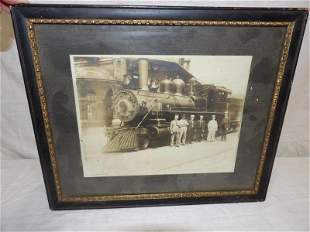 Vintage steam engine train photo with railroad personne