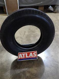 Atlas metal tire display with Atlas tire