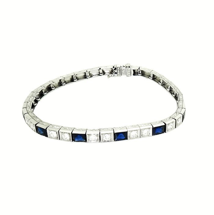 Platinum Filigree Diamond and Sapphire Tennis Bracelet.