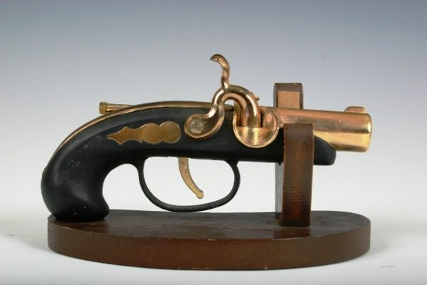 12: Early 20th c Pistol Shaped Lighter on Stand