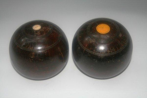 21: Two Antique Bacchi Balls