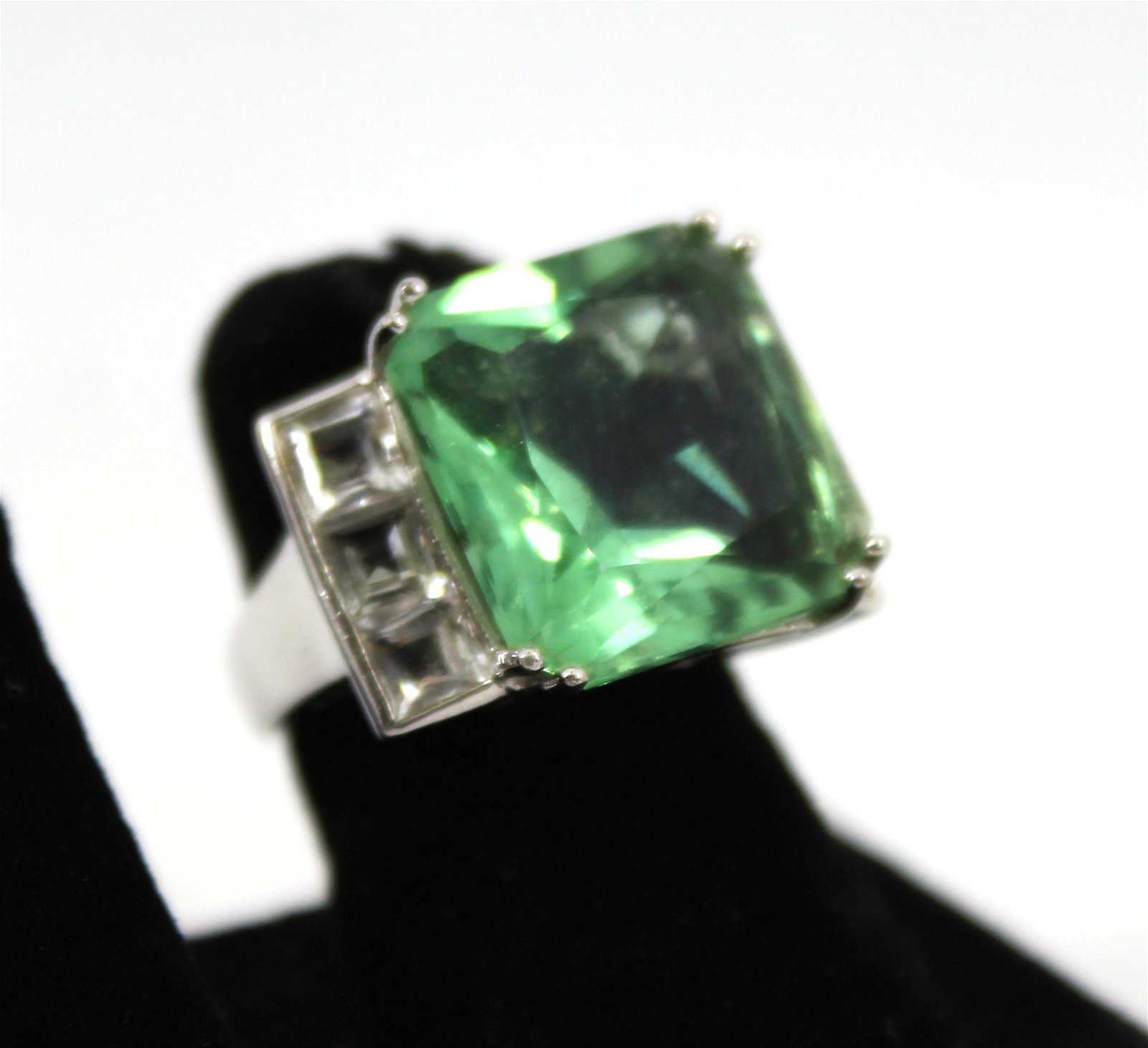 Silver, Green Stone, and White Topaz Ring
