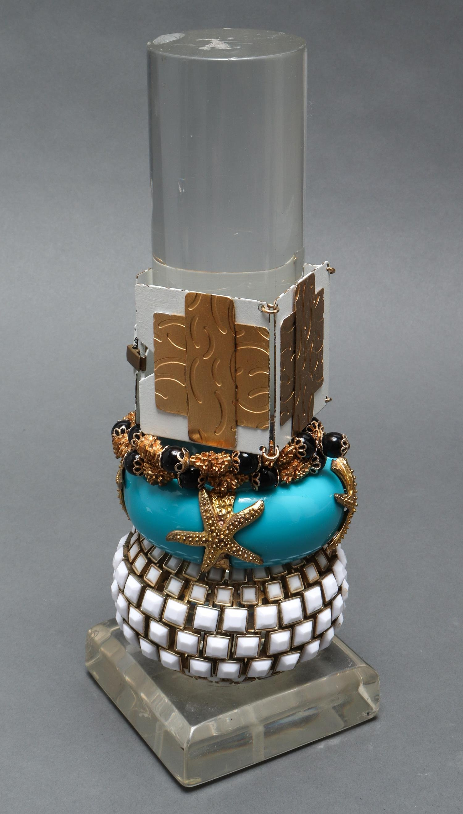 Bracelets w Gold Tone Metal on Lucite Stand, 4