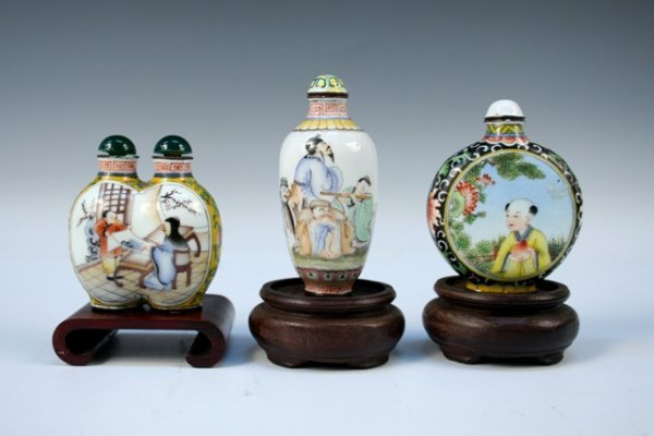 Three Chinese Enamel Snuff Bottles with Bases