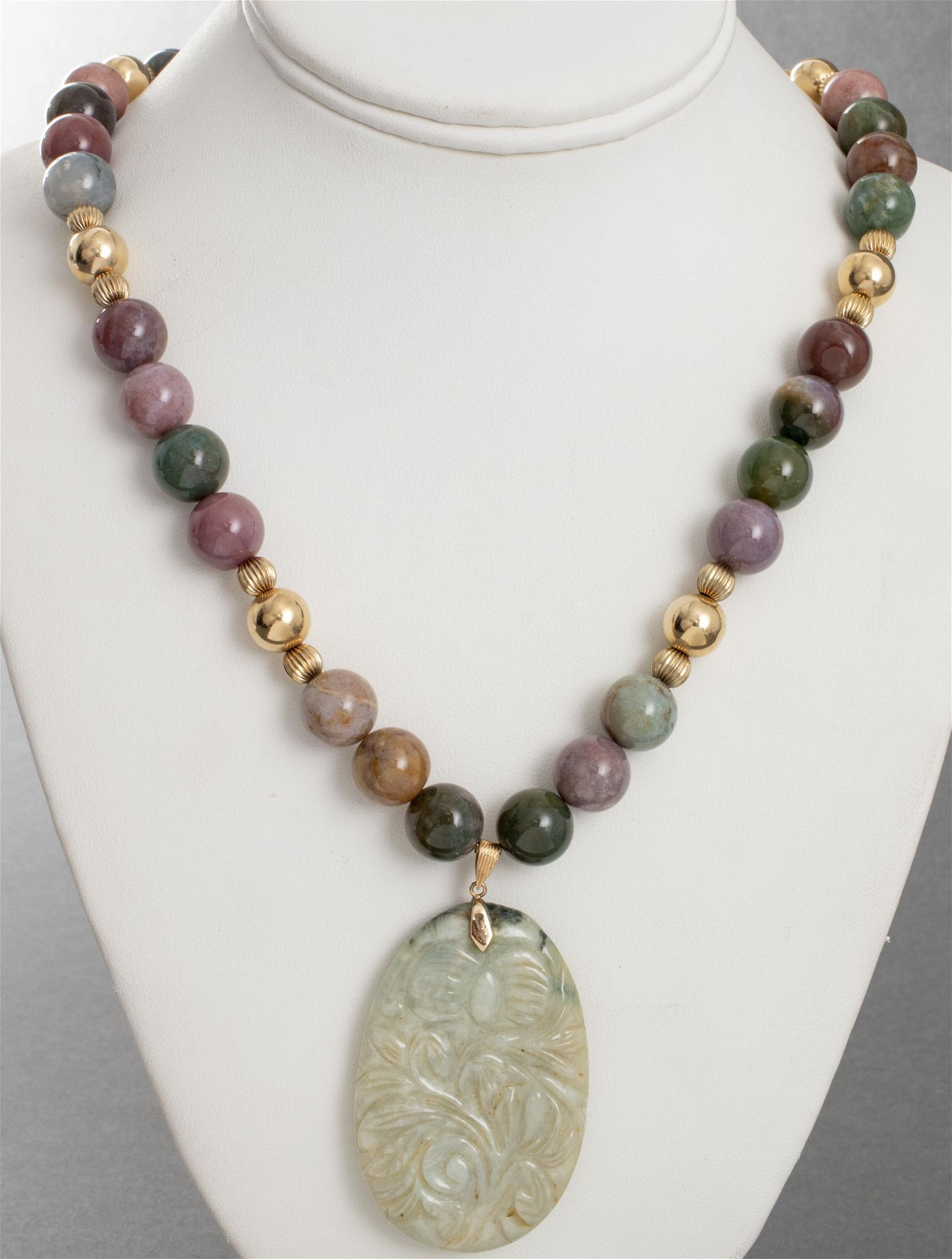 Carved Jade Colored Stone Pendant Necklace