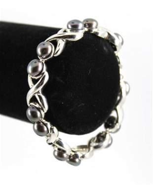 """Silver """"X"""" Gray Button Pearl Bracelet"""