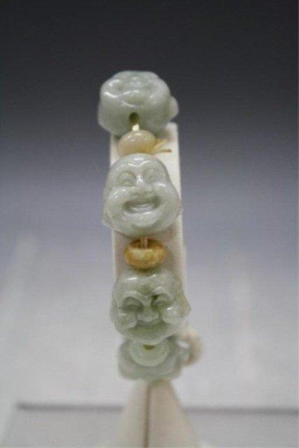101: Chinese Carved Jade Bracelet w/ Buddha Heads