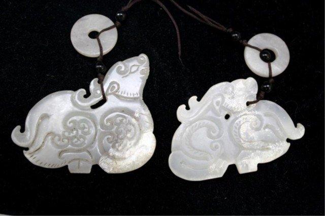 Chinese Pair of White Jade Qilin Amulets