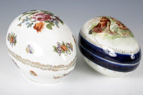 10: 2 Large Porcelain Floral Egg Shaped Boxes.