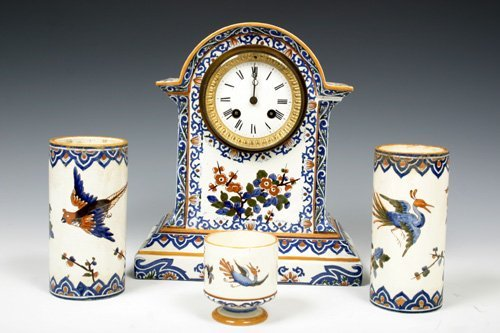 526: Asian ceramic clock with 3 cups, signed.