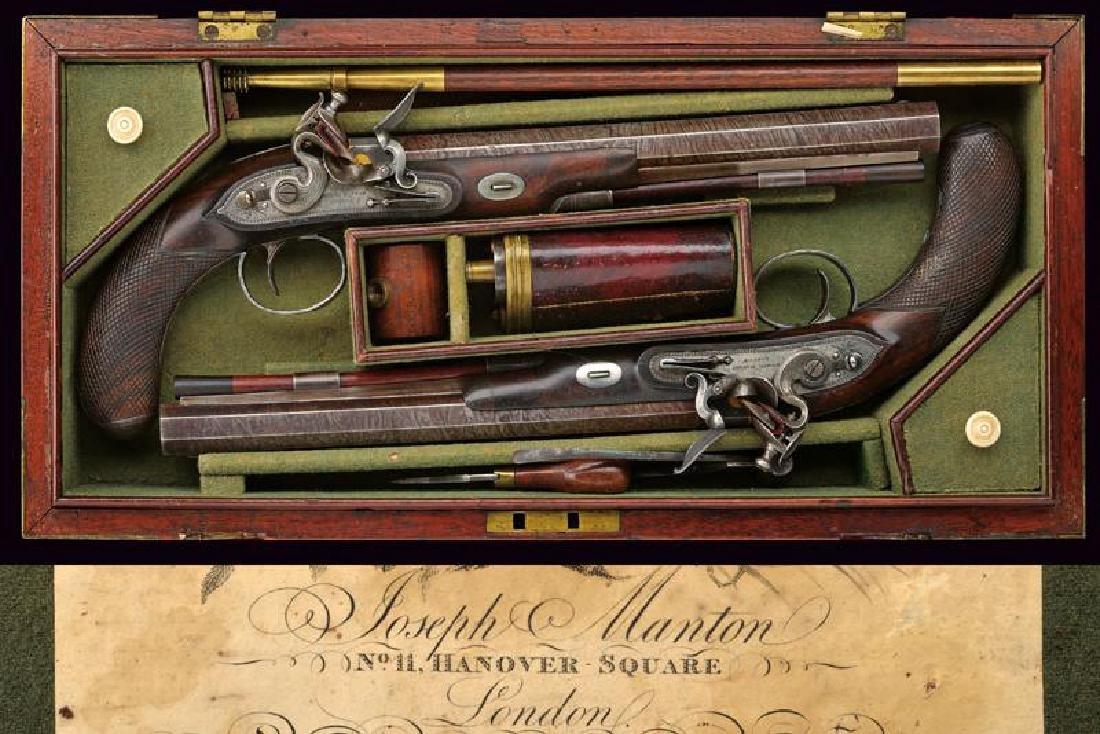 A very scarce cased pair of flintlock pistols by Joseph