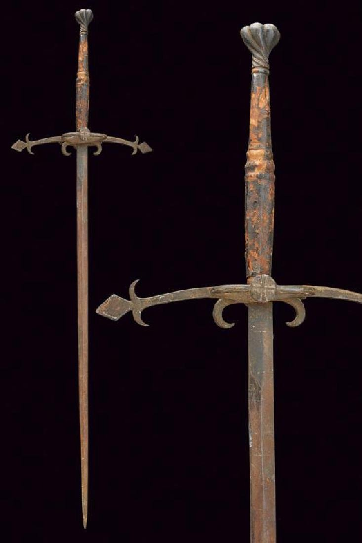 A two handed sword with antique pommel, dating: early
