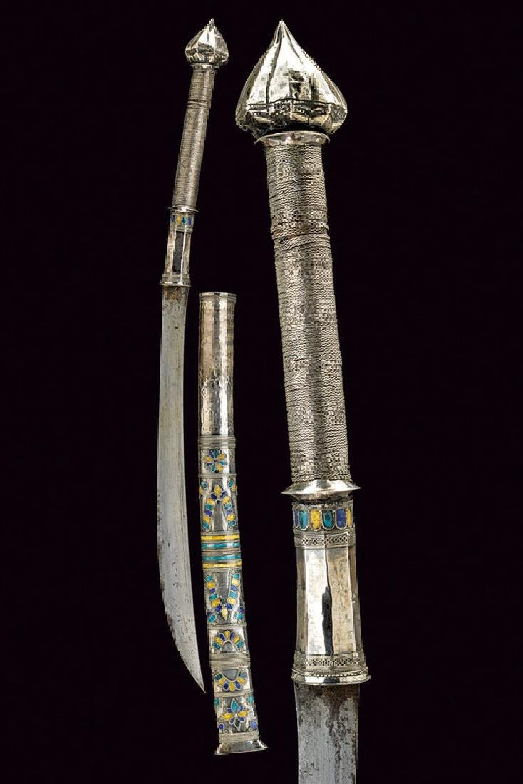 A silver mounted and enameled dha, dating: circa 1900,