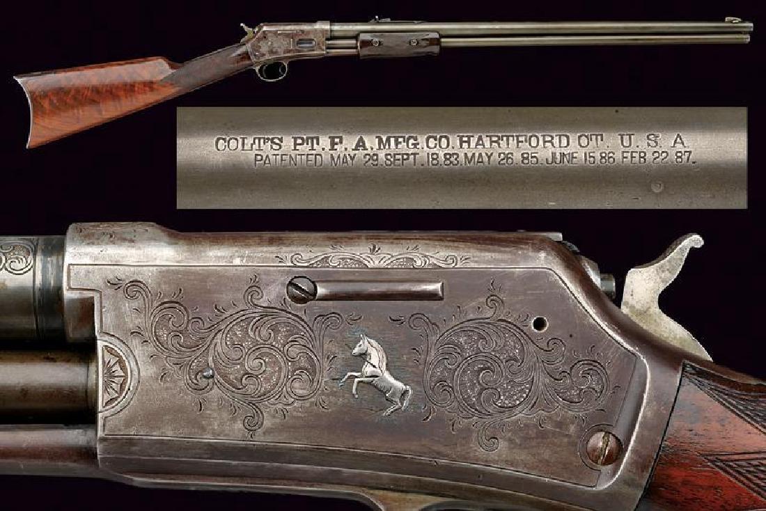 An engraved Colt Lightning Slide Action, Medium Frame,
