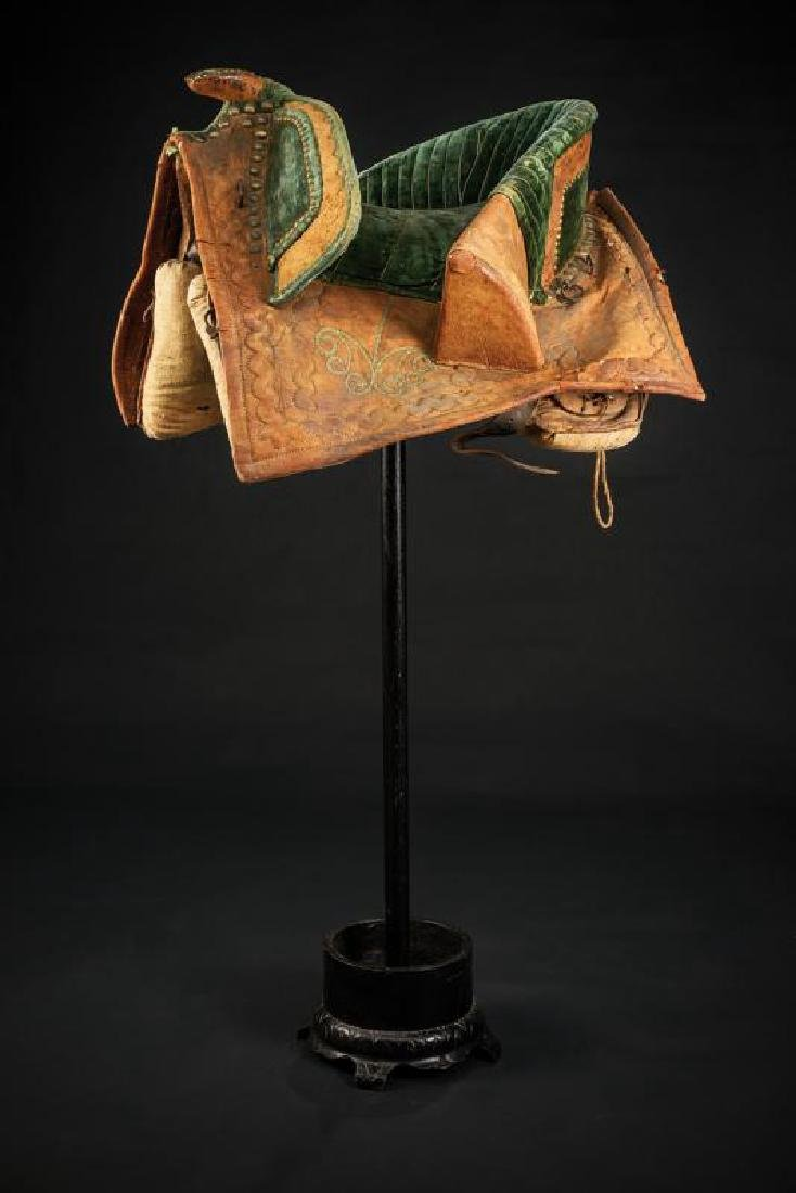 A very rare velvet decorated saddle