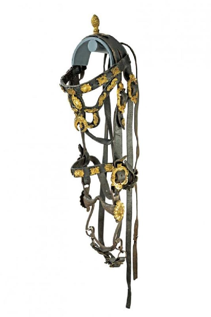A fine leather bridle with gilded brass mounts and bit