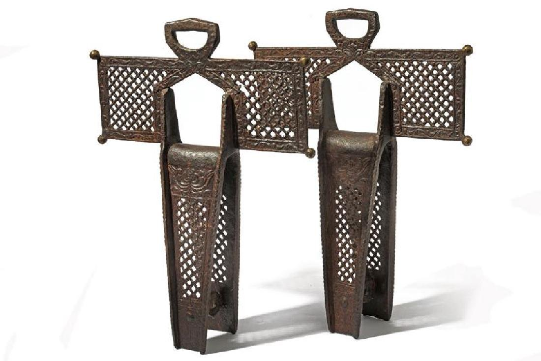 A rare scarce pair of cruciform stirrups