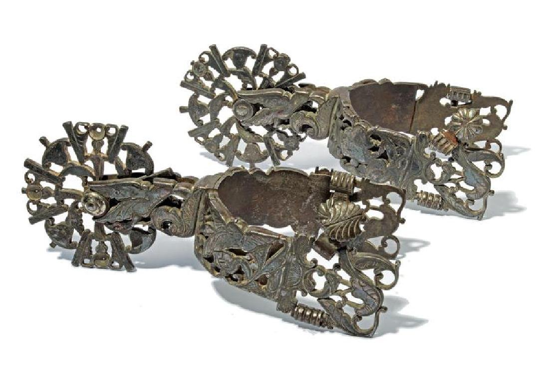 A beautiful pair of silver mounted spurs