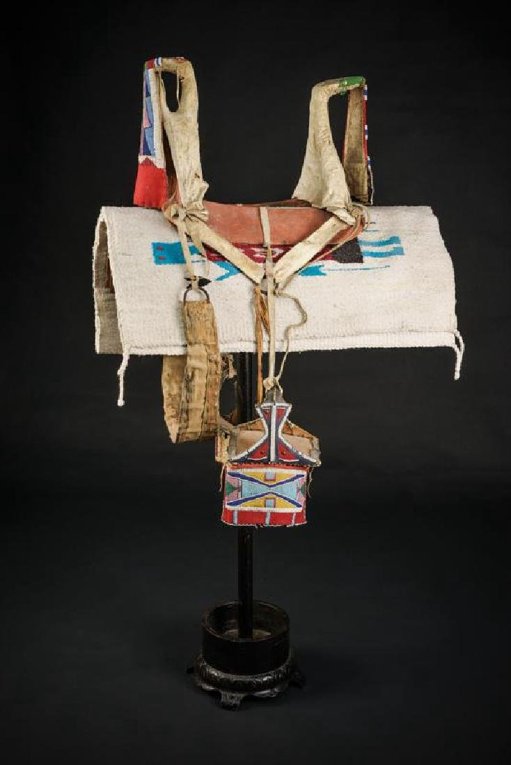A rare saddle of the Crow tribe with stirrups and