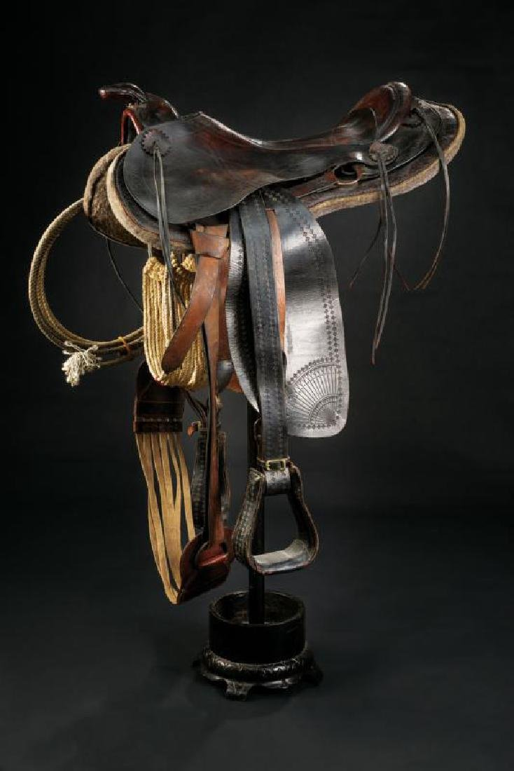 A Western saddle with stirrups and lasso