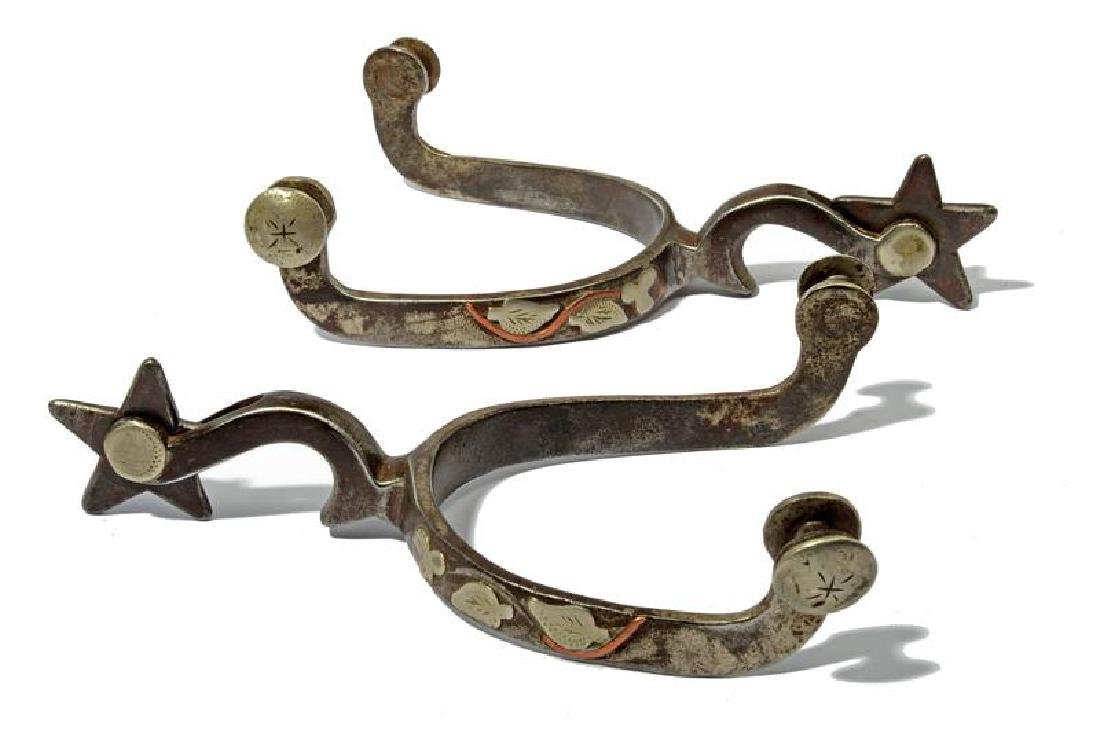 A pair of silver decorated McChesney spurs
