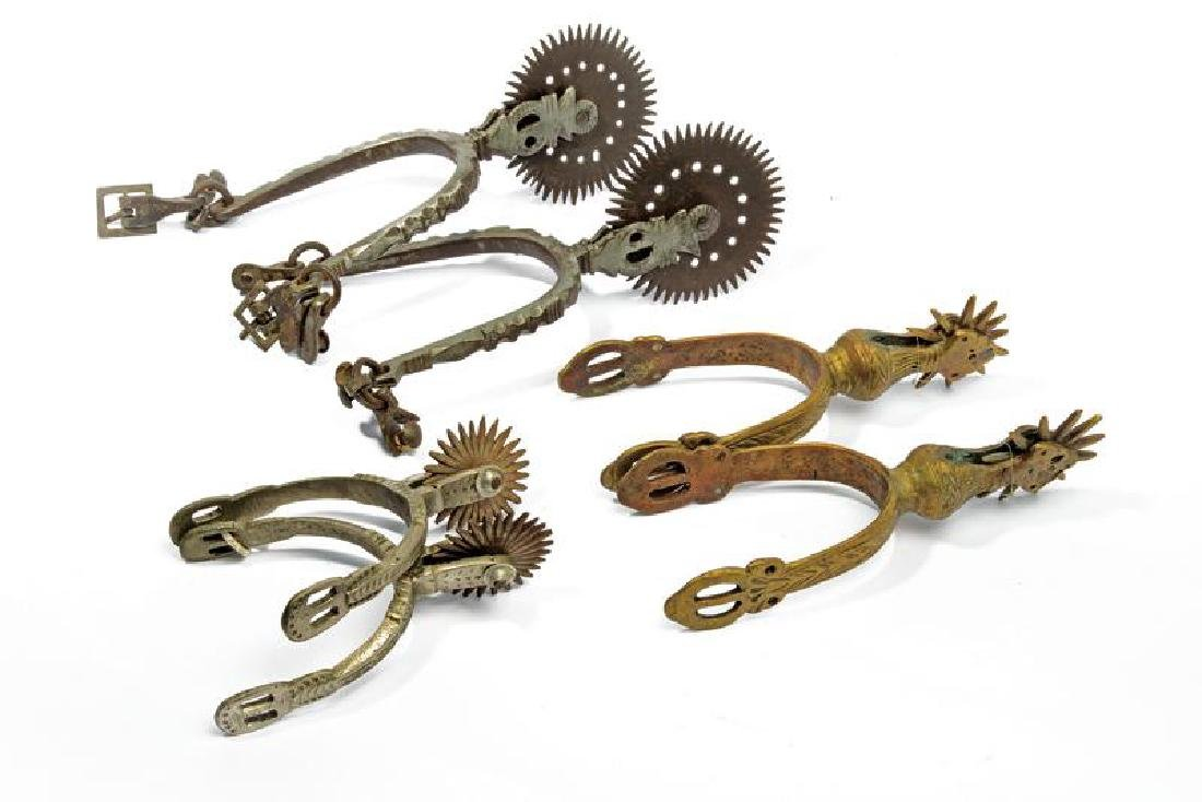 A lot of three pairs of spurs