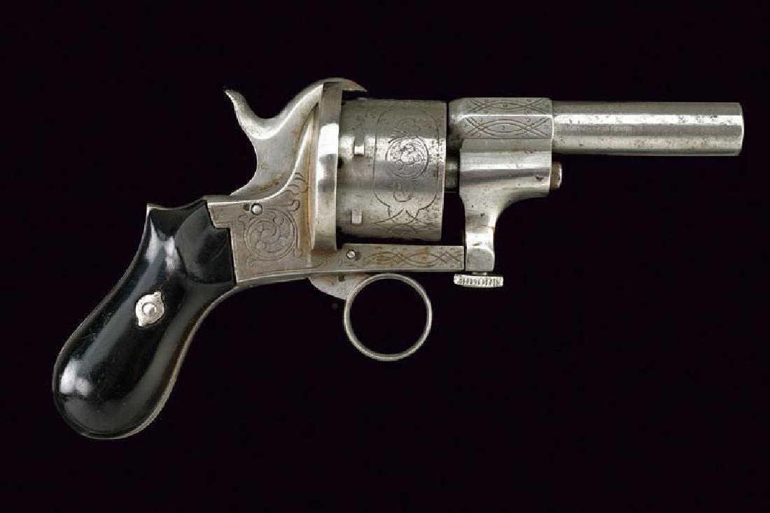 A pin fire revolver