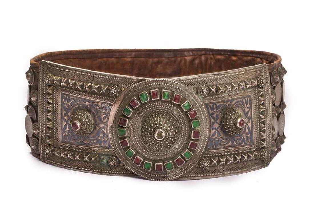 A beautiful silver mounted belt decorated with stones