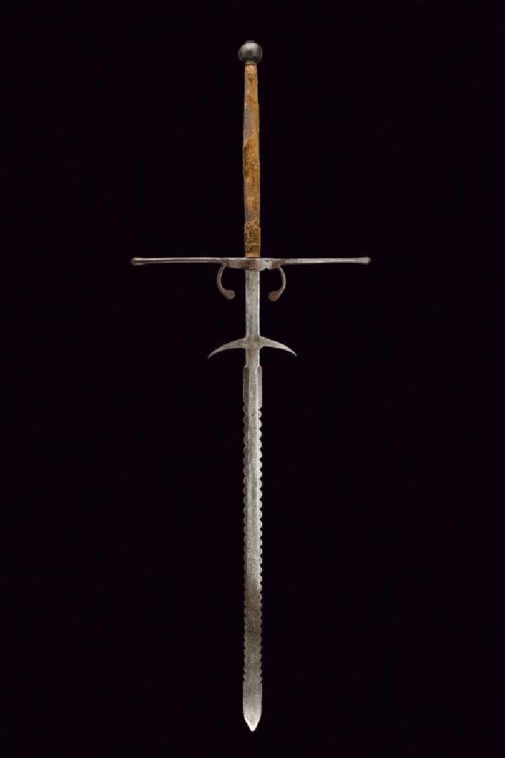 A double handed sword with engraved blade