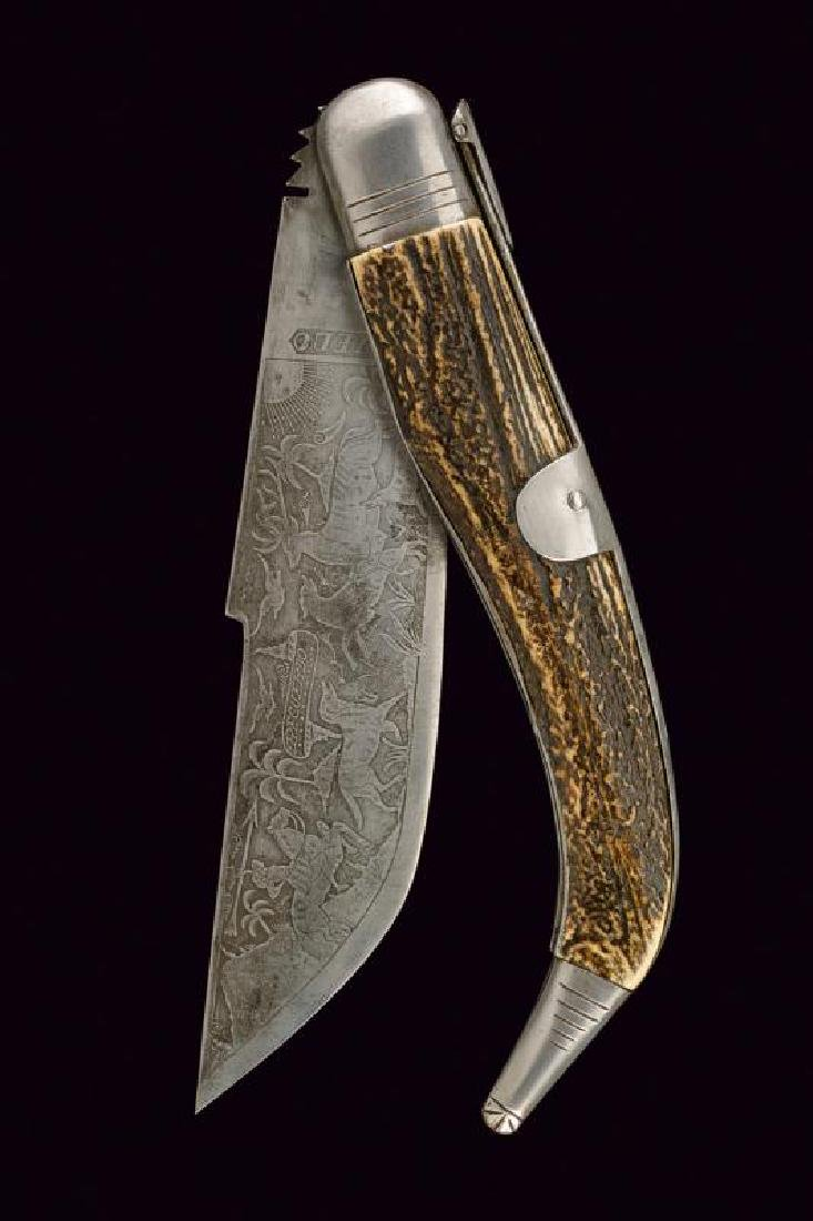 A folding knife with engraved blade
