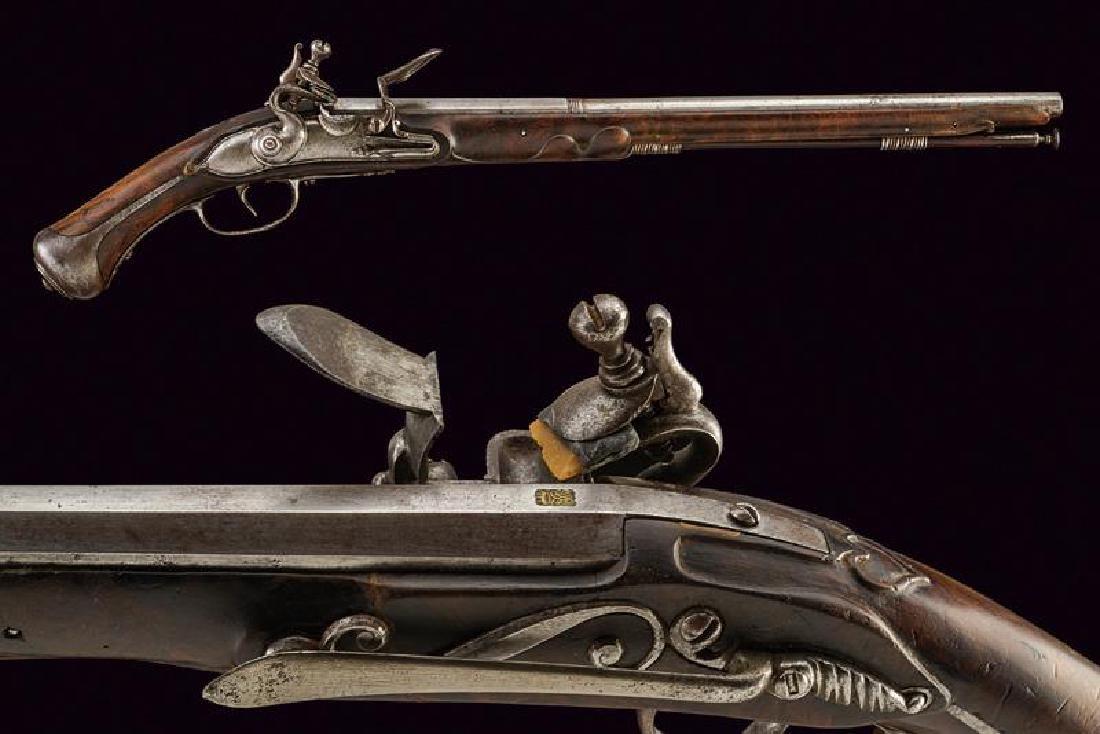 A flintlock holster pistol by Lelli