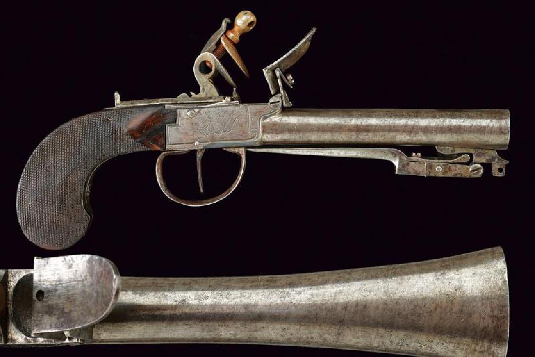 A flintlock blunderbuss pistol with spring bayonet