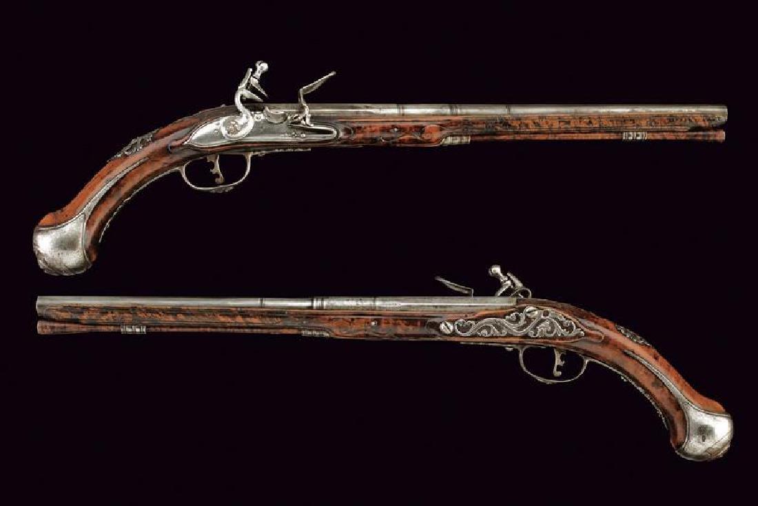 A pair of long flintlock pistols by Catane